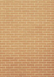 Closeup of orange yellow brick wall as background or texture Stock Images