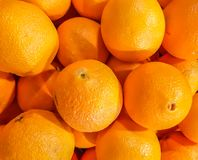 Closeup of oranges on a market . Stock Image