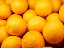 Closeup of many oranges on a market. Background stock photo