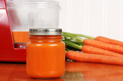 Closeup organic carrot baby food Stock Photos