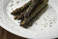 Closeup of Organic Cooked Purple Asparagus with Coarse Salt and Stock Photography