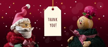 Closeup of an ornate Santa Clause and Gingerbread with THANK YOU' at the center