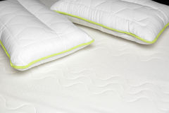 Closeup of orthopedic mattress and pillows Stock Images