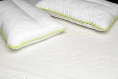 Closeup of orthopedic mattress and pillows. Closeup of white orthopedic mattress and pillows Stock Images