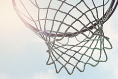 Closeup of outdoor basketball hoop net. Against sky Royalty Free Stock Photography