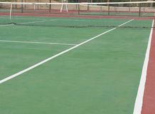 Closeup of outdoor clay tennis court with net Royalty Free Stock Image