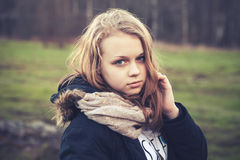 Closeup outdoor portrait of blond teenage girl Royalty Free Stock Photography