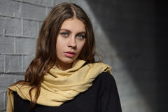 Free Closeup Outdoor Portrait Of Young Adorable Brunette Woman With Wavy Long Hair Looking Into Camera Posing Against Painted Brick Wal Stock Photo - 71319420