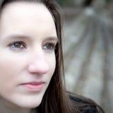Closeup outdoor portrait of a pretty young woman Stock Photos