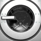 Washing Machine Drum. A closeup from the outside of an industrial washing machine looking inwards towards the closed door and empty drum - 3D render stock illustration