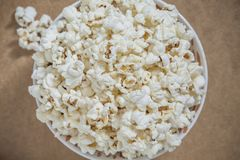 Closeup overhead view on popcorn. Delicious snack while watching movies Stock Photography