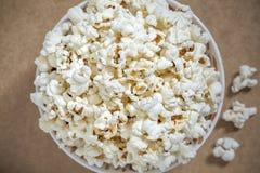 Closeup overhead view on popcorn. Unhealthy snack, corn Royalty Free Stock Photos