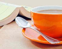 Closeup of orange coffee cup Royalty Free Stock Photos