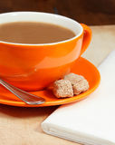Closeup of orange coffee cup. Closeup overview of orange coffee cup on table top Royalty Free Stock Photos