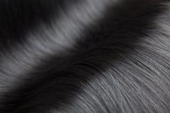 Closeup på lyxigt glansigt svart hår fotografering för bildbyråer