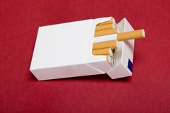 Closeup of packet cigarettes. On red background Stock Photo