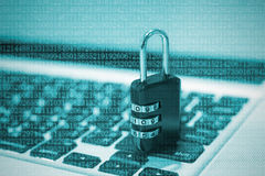 Closeup padlock on computer keyboard for concept technology data Stock Image