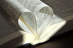 Closeup pages of an open book,  with heart shaped pages Royalty Free Stock Image