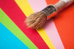 Paint brush on colorful palette background royalty free stock photo