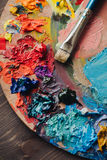 Closeup of paint mixing process in art workplace. Stock Image