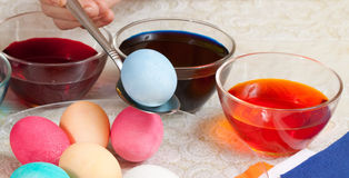 Closeup of painting eggs Stock Images