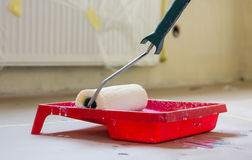 Closeup of painting roller. Professional redecorating your home Stock Photography