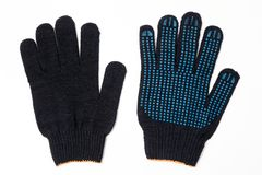 Closeup pair of black textile knitted gloves with professional blue rubber protective anti-slip coating isolated on white stock photo