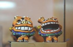 The guardian Shisa lion dogs , Okinawa, Japan. Closeup a pair of clay Okinawan lion dogs, also called shisa Shisa is a traditional Ryukyuan decoration from royalty free stock photography