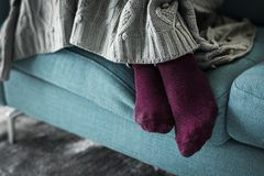 Closeup pair of legs on the sofa royalty free stock photography