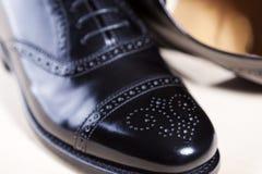 Closeup of Pair of Male Stylish Black Polished Oxford Semi-Brogu. E Laced Shoes. Horizontal Image Orientation royalty free stock photo
