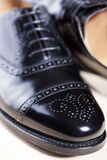 Closeup of Pair of Male Stylish Black Polished Oxford Semi-Brogu. E Laced Shoes. Vertical Image Orientation stock photos