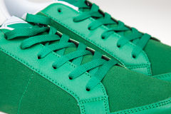 Closeup of a pair of new green sneakers. Pair of new green sneakers stock images