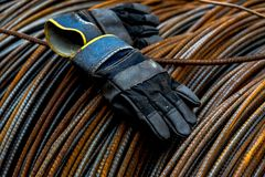A pair of gloves with metal background. Closeup of an pair of old abandoned gloves with rusted metal background royalty free stock image