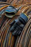 A pair of gloves with metal background. Closeup of an pair of old abandoned gloves with rusted metal background stock photos
