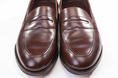Closeup of Pair of Stylish Brown Penny Loafer Shoes On White Stock Photo