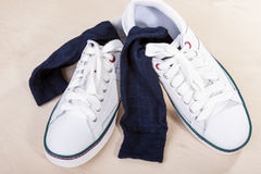 Closeup of Pair of White Trainers with Socks Inserted Inside. Royalty Free Stock Photo
