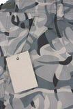 Closeup pale green camoflauge pocket shorts with t. Closeup pale green camouflage pocket pants with tag Stock Images