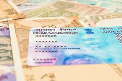 Closeup of PAN card with Indian currency. royalty free stock image