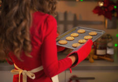 Closeup on pan with christmas cookies in hand of housewife Stock Photo