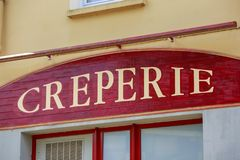 Pancake restaurant sign (Creperie in French). Brittany, France. Closeup on Pancake restaurant sign (Creperie in French). Brittany, France royalty free stock image