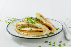 Closeup of pancakes with cottage cheese and chive. On white background Stock Photography