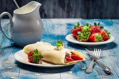 Closeup of pancakes with strawberries and whipped Cream royalty free stock photos