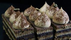 Closeup panorama on chocolate cake slices stock video