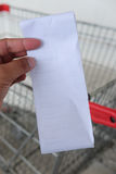 Closeup of paper receipt bill in human hand Stock Photography
