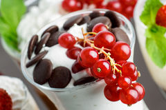 Closeup of parfait. Parfait decorated with red currant. Delicious layered dessert. Sweet food Royalty Free Stock Images