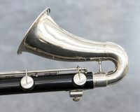Closeup of part of bass clarinet with grey background. Closeup of part of bass clarinet with gray background Royalty Free Stock Photography