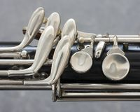 Closeup of part of bass clarinet with grey background. Closeup of part of bass clarinet with gray background Royalty Free Stock Images