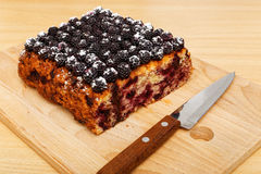 Closeup part of cake with black raspberries Royalty Free Stock Photography