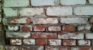 Closeup of a part of an old brick wall. Rough white and red brick masonry. royalty free stock photo