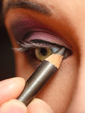Closeup part of woman face eye makeup detail. Royalty Free Stock Images